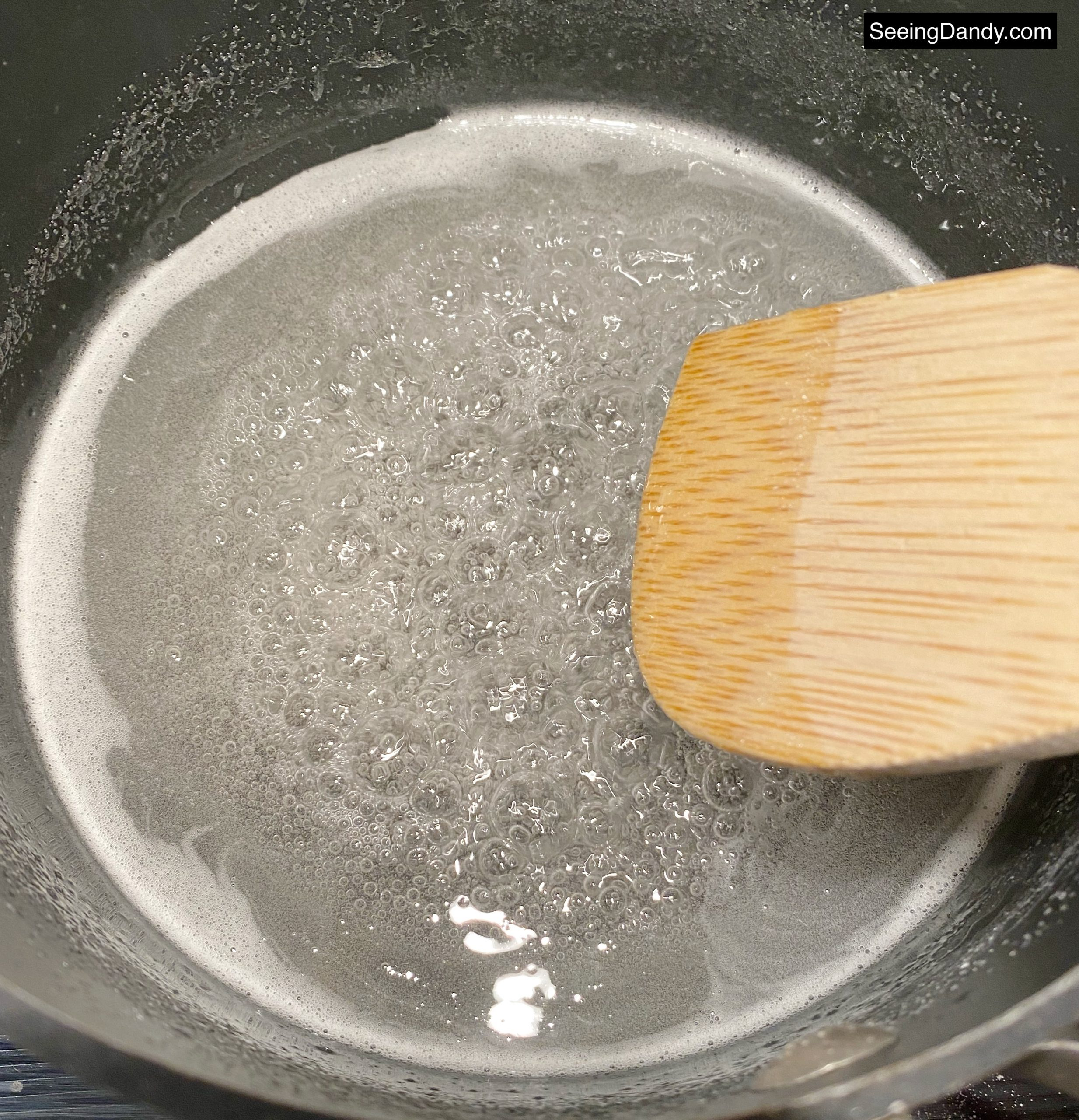 boiling saucepan, sugar, salt, cream of tartar, wooden spoon