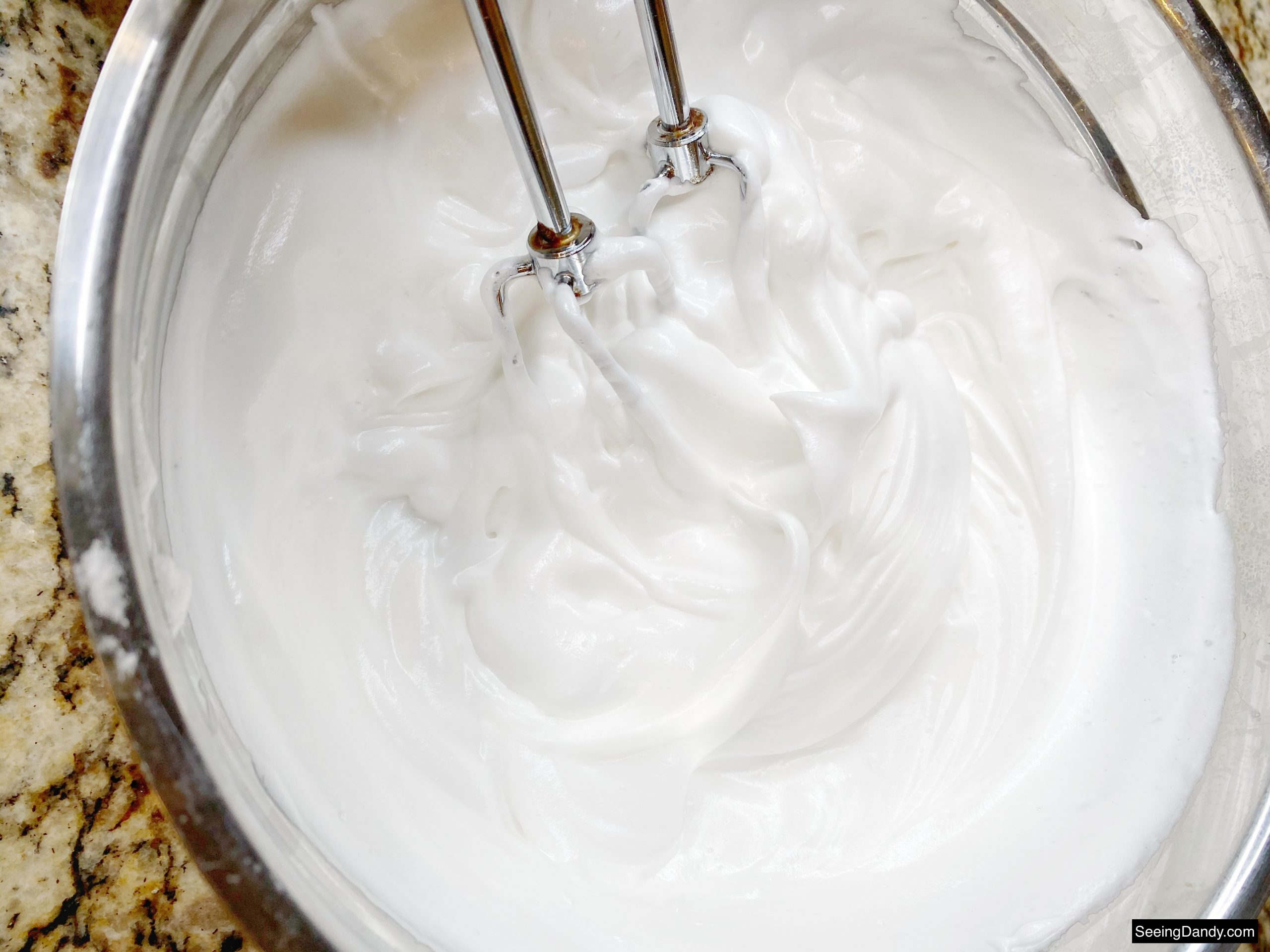 cream of tartar icing recipe, silver mixing bowl, mixer beaters, cupcake icing, granite countertop