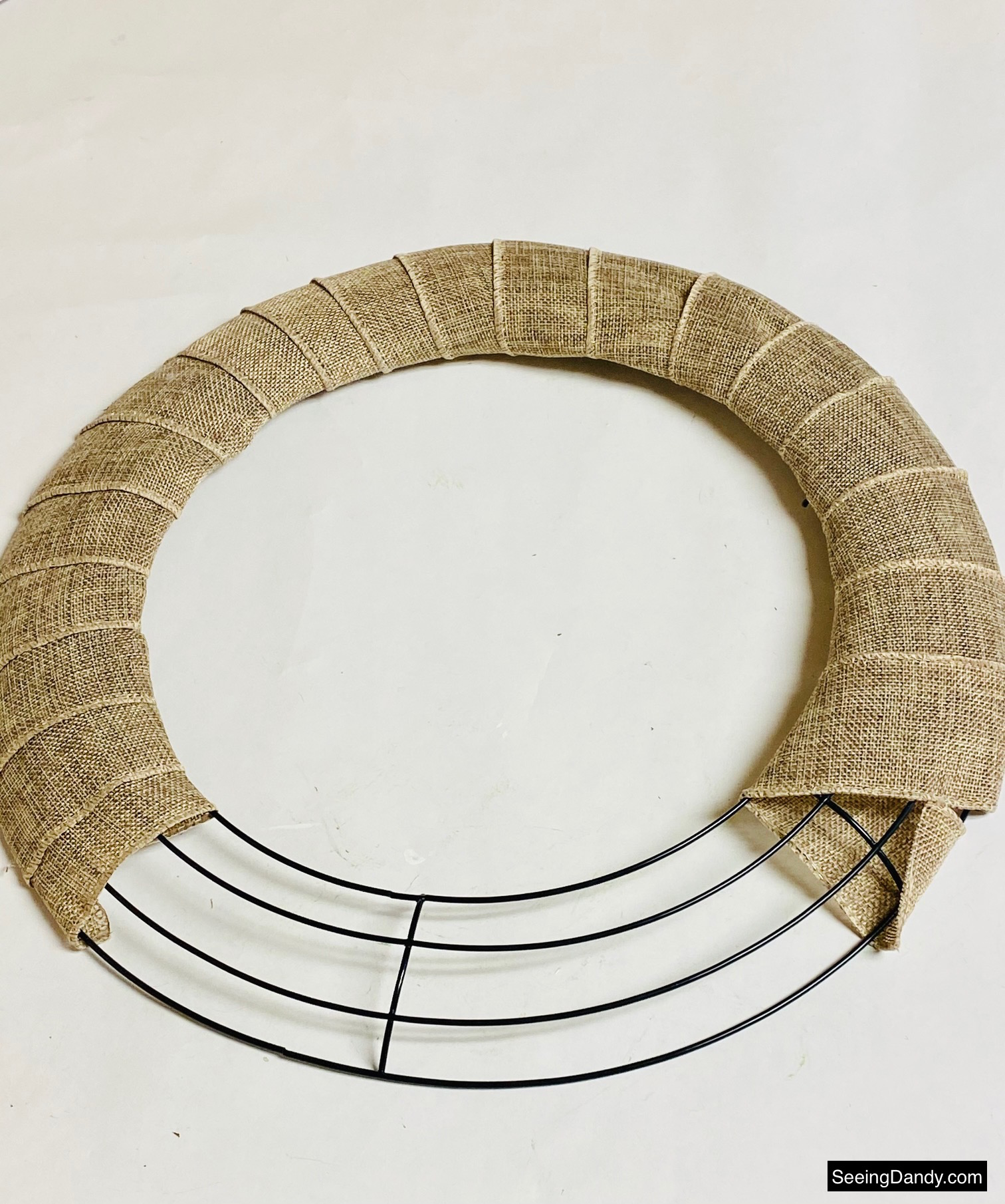 dollar tree metal wreath form, burlap ribbon
