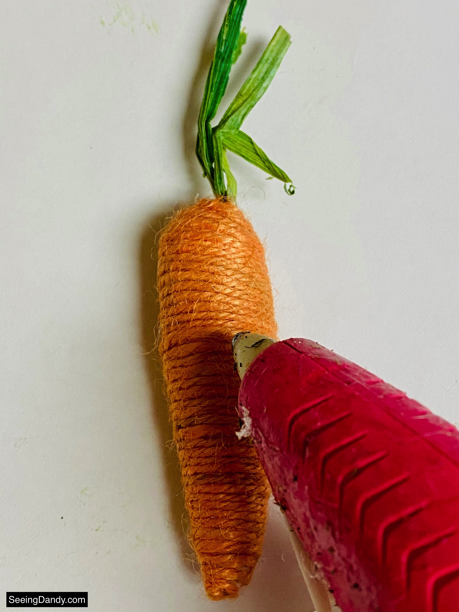 Dollar Tree twine carrot, pink hot glue gun