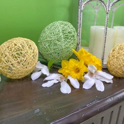 yellow string egg, green string egg, bakers twine easter eggs, string balloon egg, springtime, spring decor, easter decorations, farmhouse style, floral tree branch, spring flowers, yellow daffodils