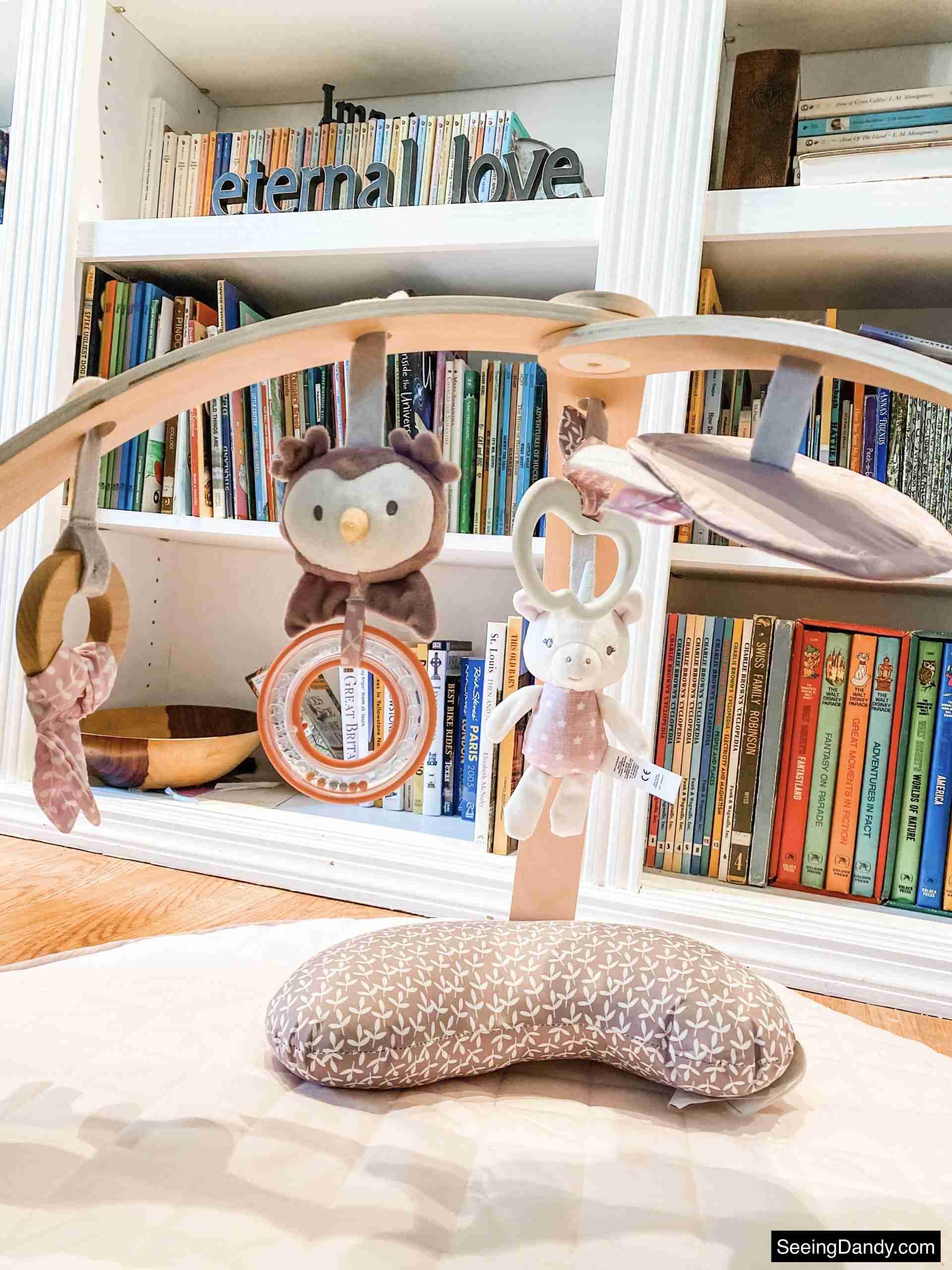 newborn gear, cozy spot activity gym, white bookcases, vintage disney books, calla duvet play mat, infant gift ideas, infant toys