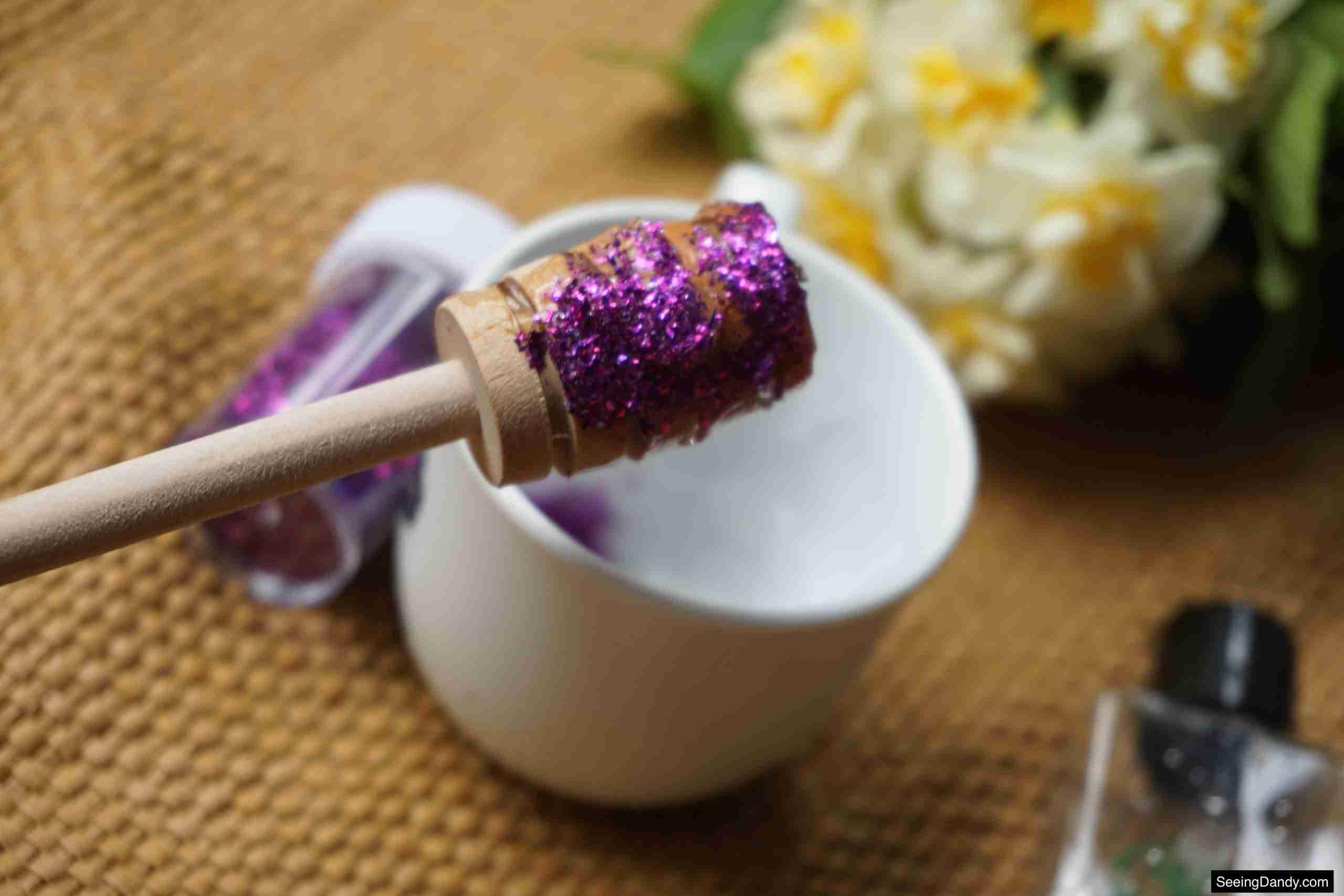 honey dipper stick, jute rug, white tea cup, purple glitter