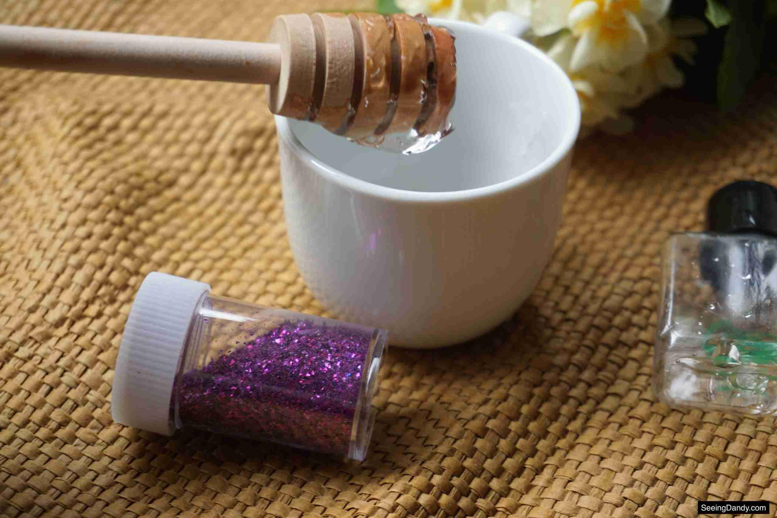 aloe vera glitter gel recipe, honey dipper stick, white tea cup, beauty recipe, makeup recipe, body glitter recipe, diy body glitter