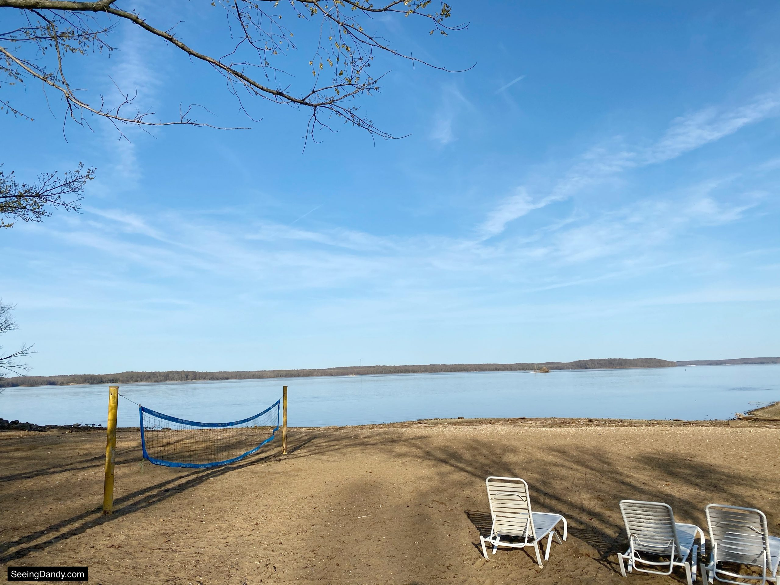 land between the lakes beach, lake barkley beach, sand volleyball, white beach chairs, kentucky lake, green turtle bay