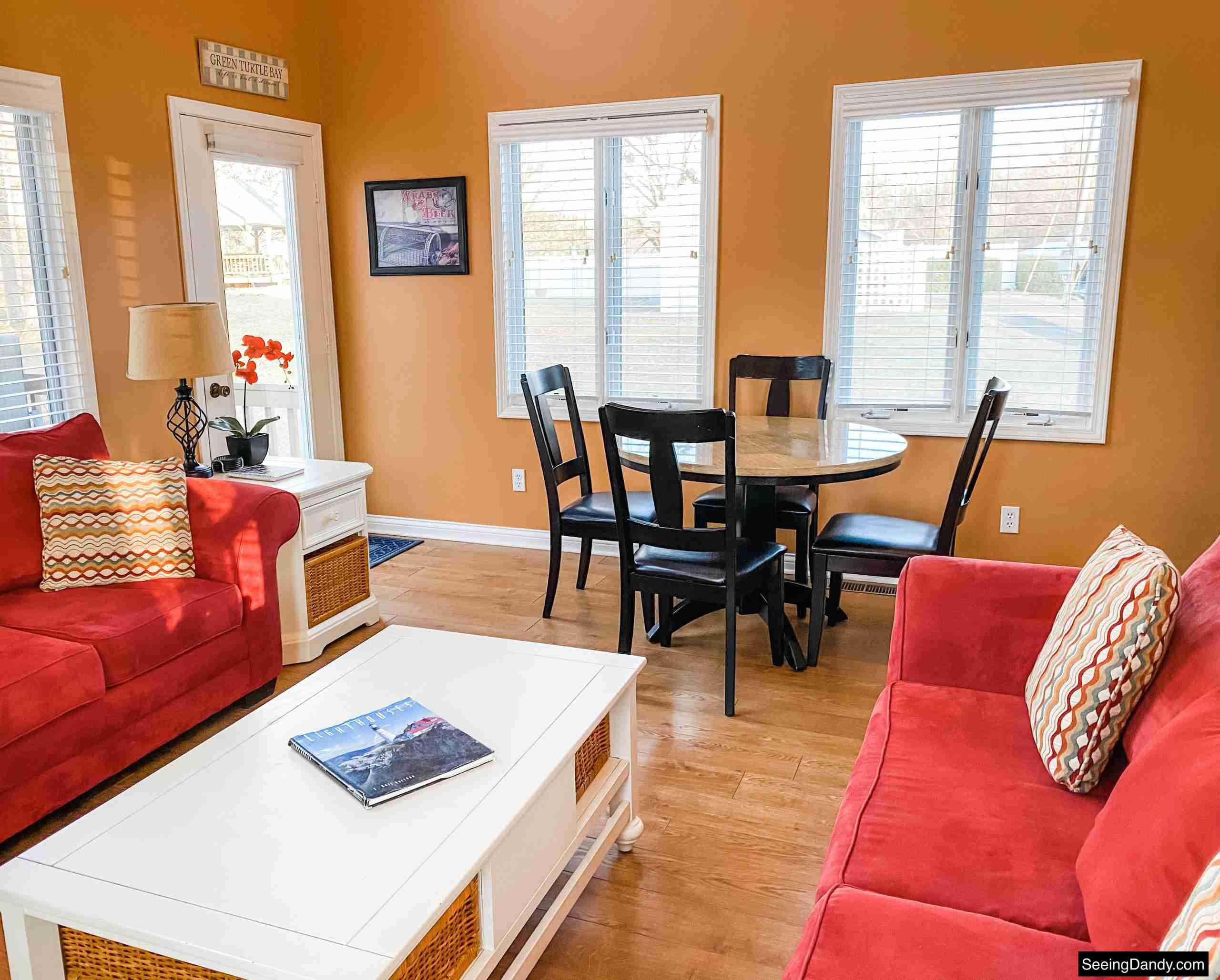 green turtle bay condo, elliebelle condo, nautical decor, lighthouse coffee table book, red sofa