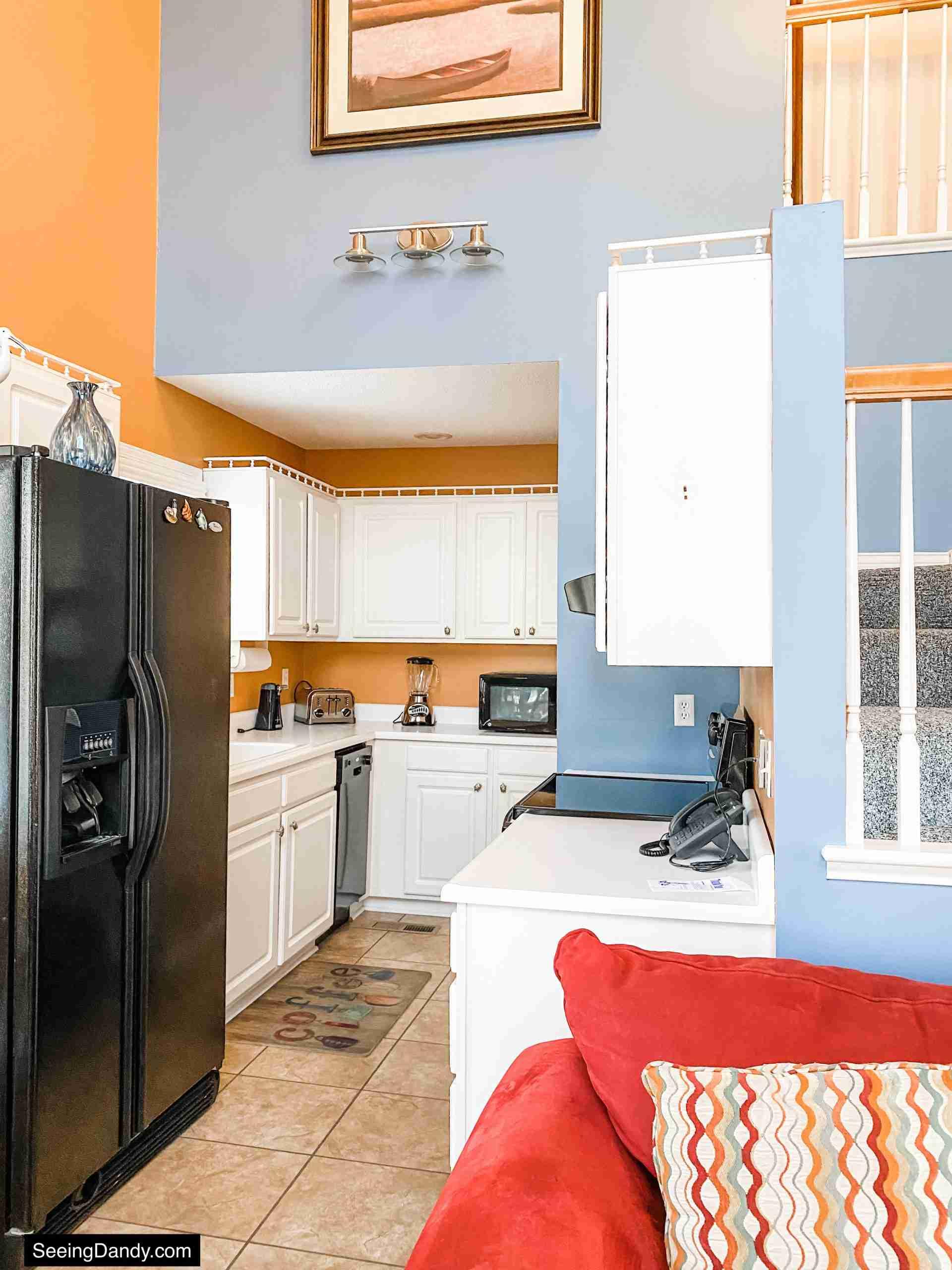 green turtle bay condo, elliebelle condo, nautical decor, galley kitchen, galley kitchen ideas, red sofa