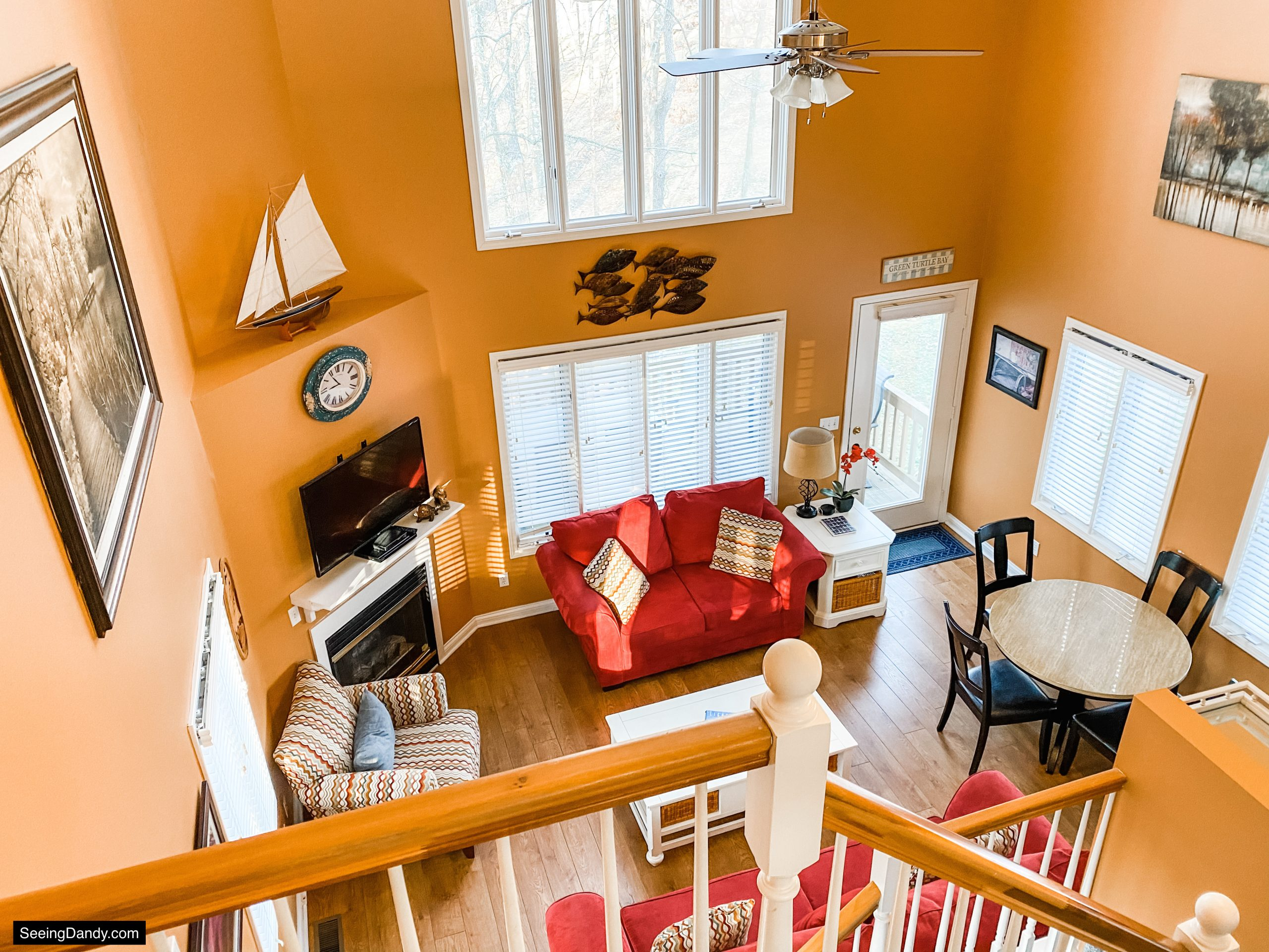 green turtle bay condo, condo staircase, red sofa, vaulted ceiling, elliebelle condo, nautical decor, land between the lakes resort