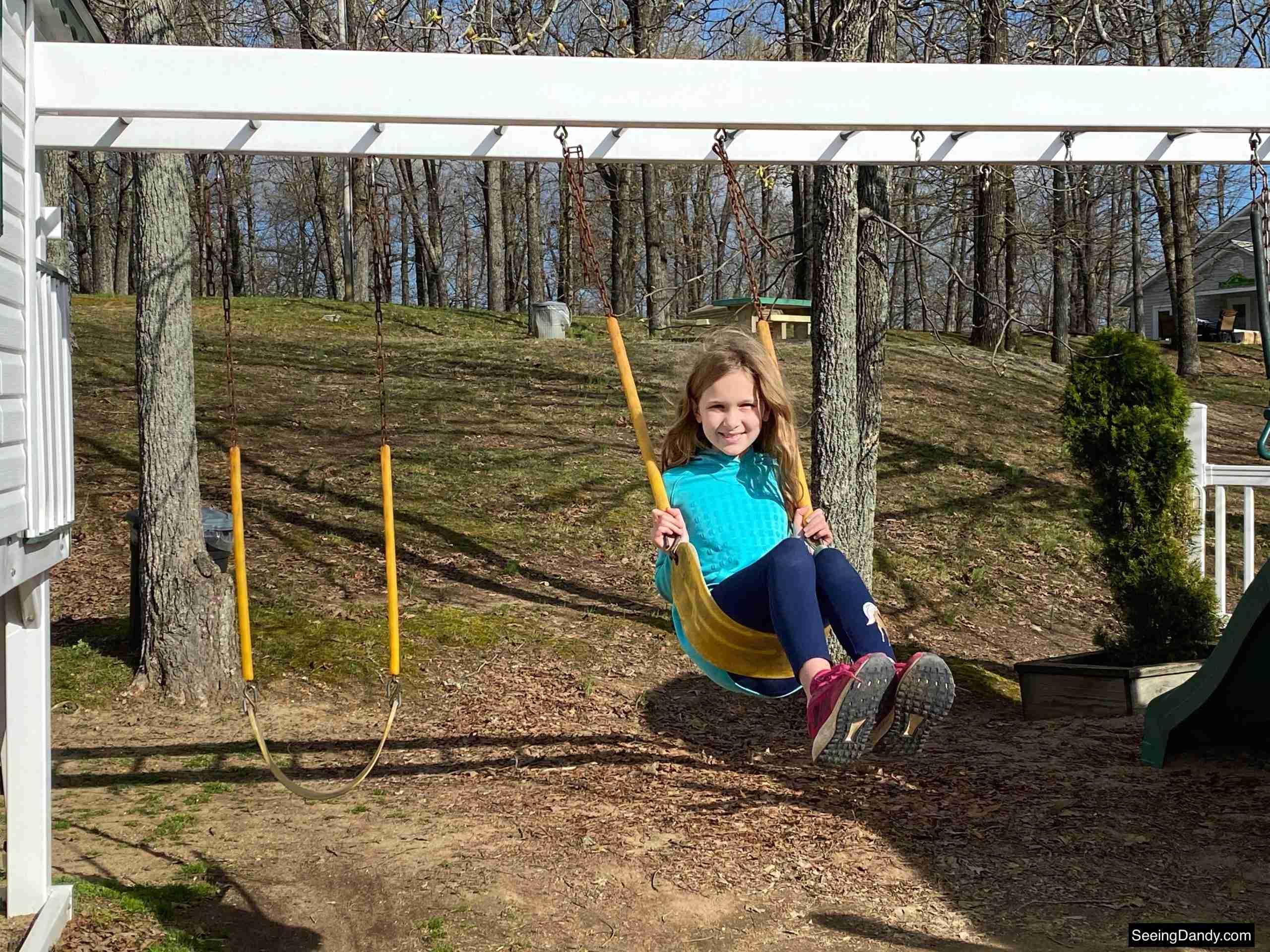 green turtle bay playground, playhouse swings, playhouse monkey bars, white playhouse, grand rivers kentucky playground, kids playhouse, family travel, lake barkley playground
