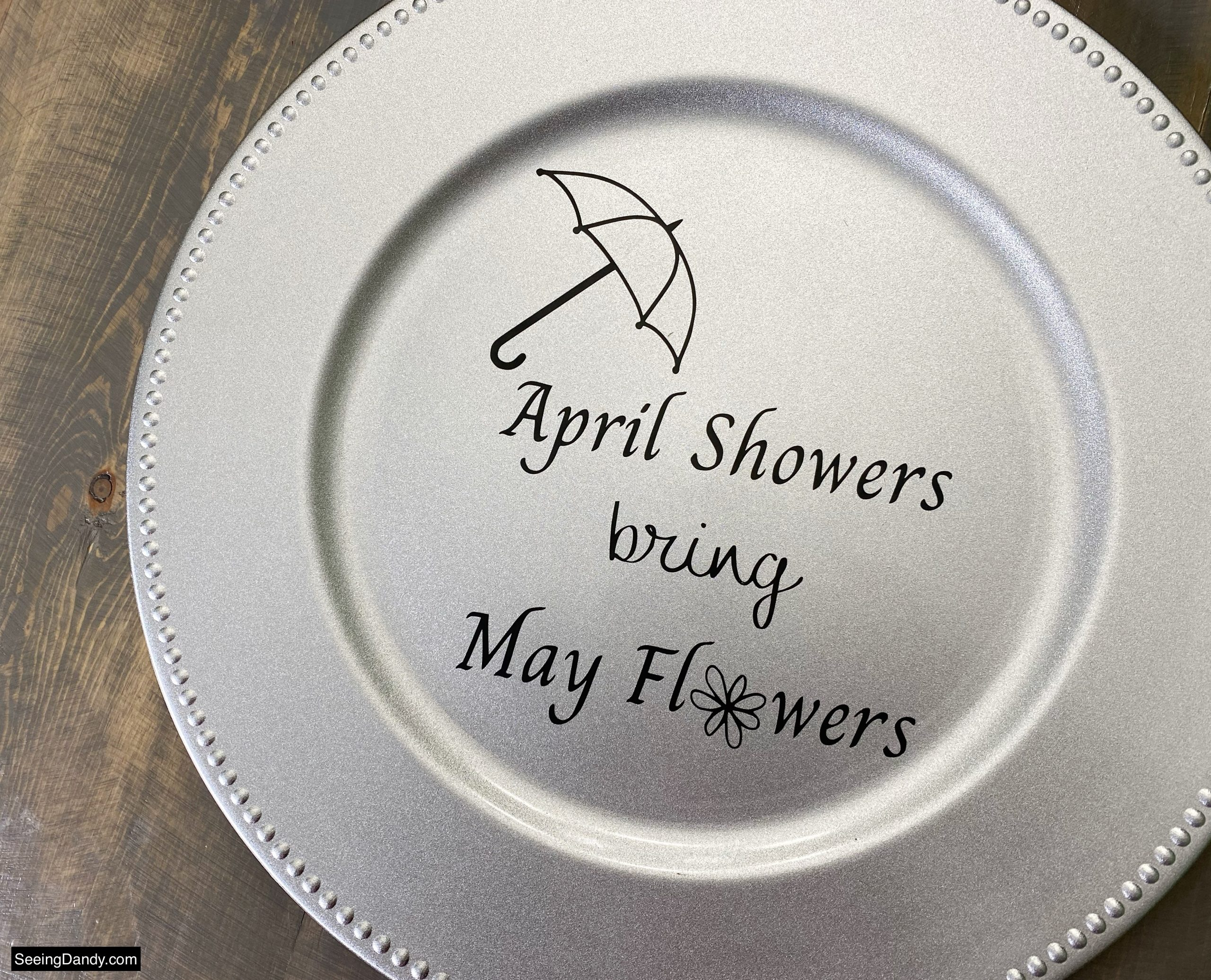 april showers bring may flowers svg file, free svg file, vinyl craft, umbrella svg file, free printables, silver dollar tree plastic charger plate, dollar tree craft ideas, farmhouse table, easy crafts