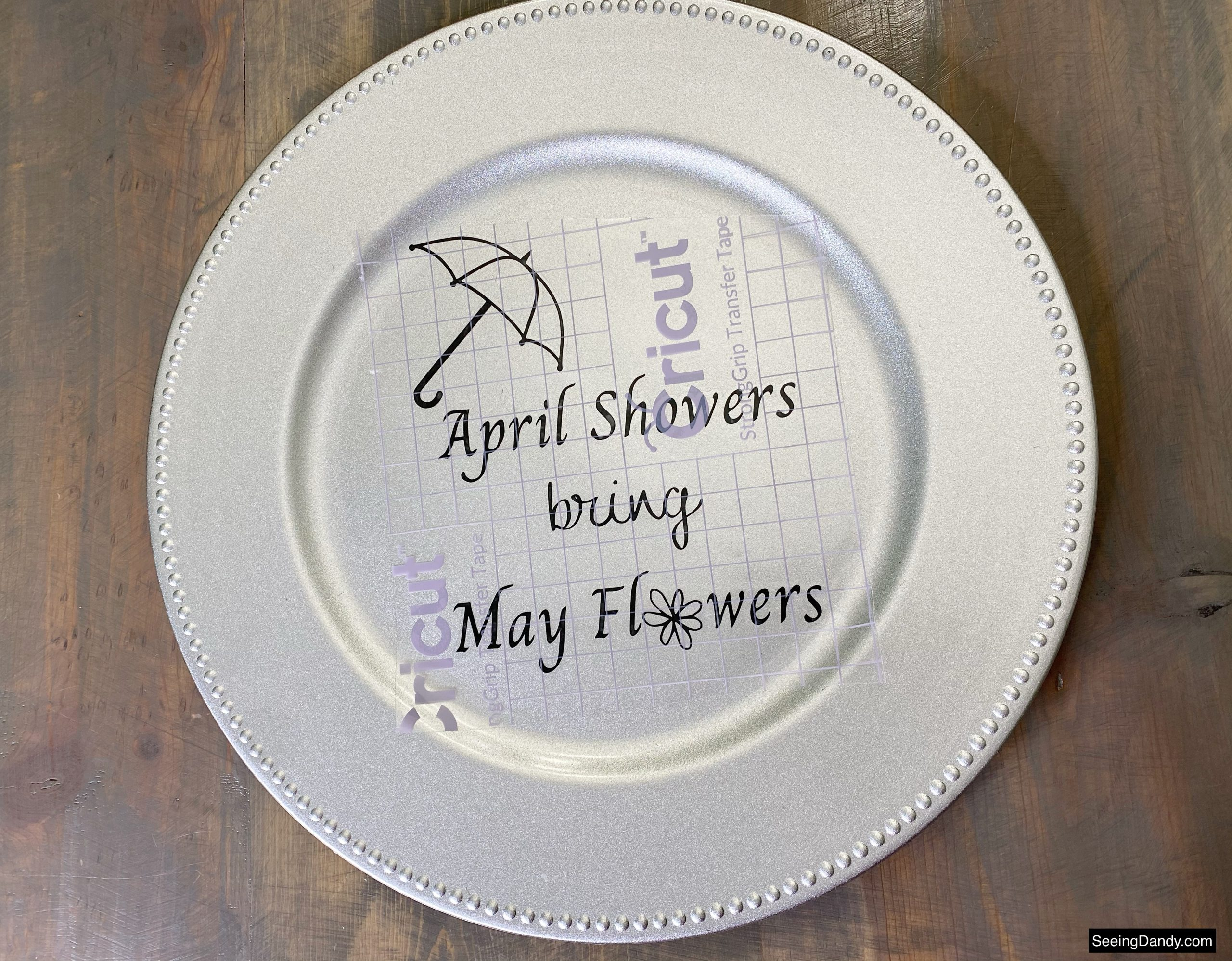 april showers bring may flowers svg file, free svg file, vinyl craft, umbrella svg file, free printables, silver dollar tree plastic charger plate, dollar tree craft ideas, farmhouse table, easy crafts, cricut strong grip transfer tape, vinyl transfer tape
