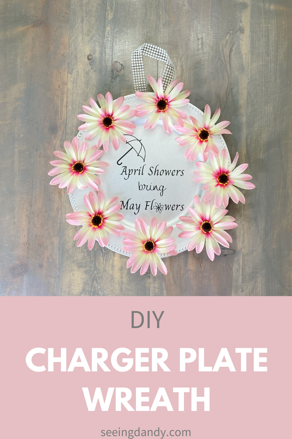 diy april showers bring may flowers sign, pink daisies, wreath ideas, springtime decor, spring wreath craft, home decor, farmhouse style, dollar tree craft, silver plastic charger plate, farmhouse table, pink spring flowers, silhouette craft, cricut craft
