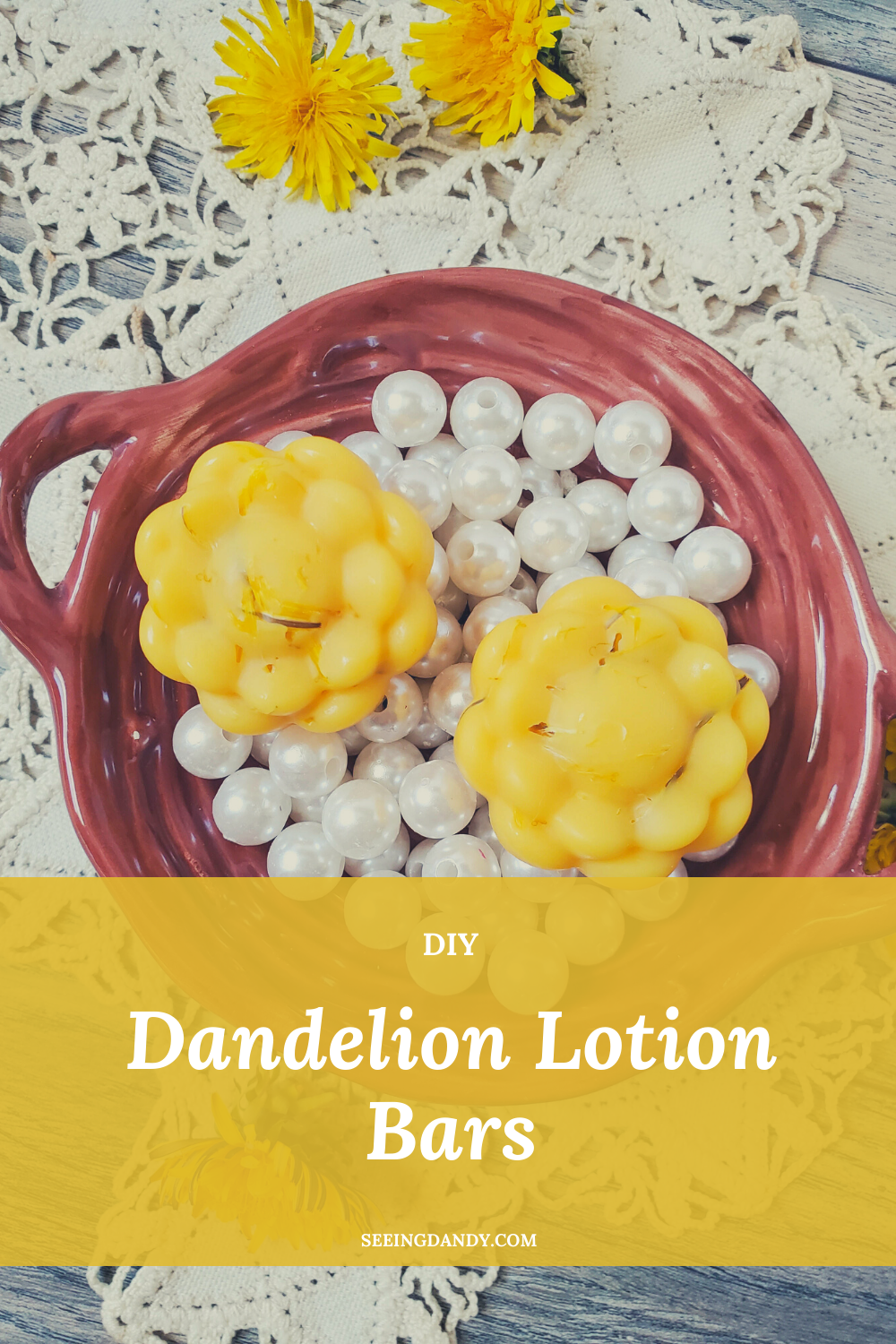 dandelion lotion bars, white pearls, yellow dandelion flowers, red ceramic dish, antique lace doily, diy beauty recipe, diy lotion, dandelion flowers, summer flower, beauty recipes, farmhouse table