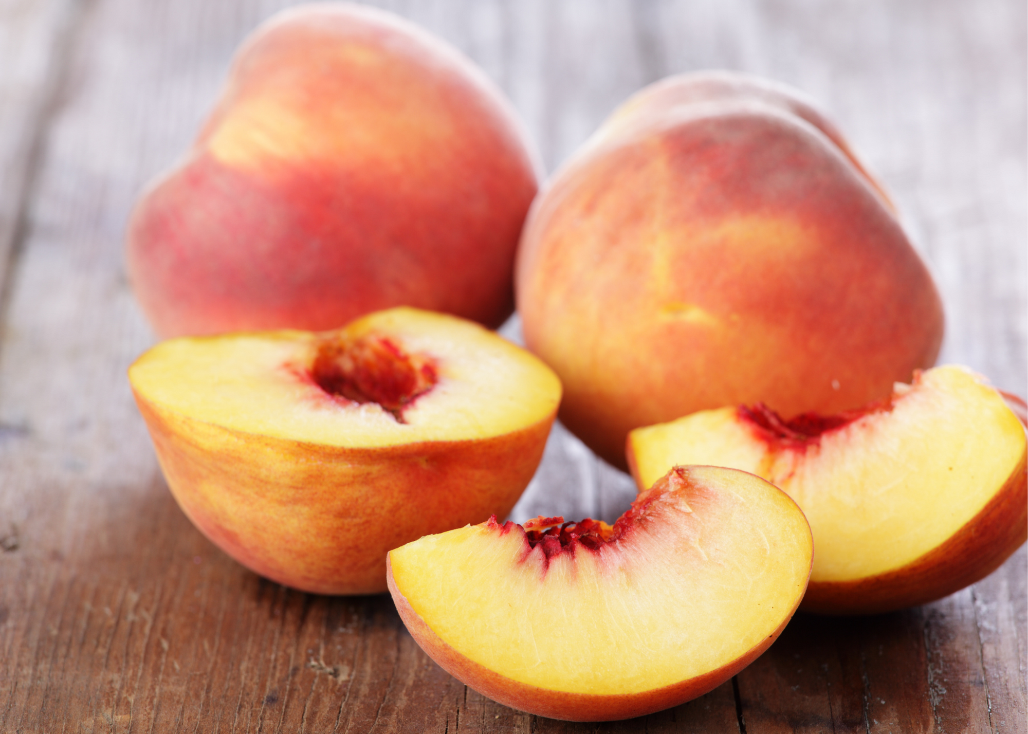 wood farmhouse table, peaches, peach slice, peach halves fresh fruit peaches