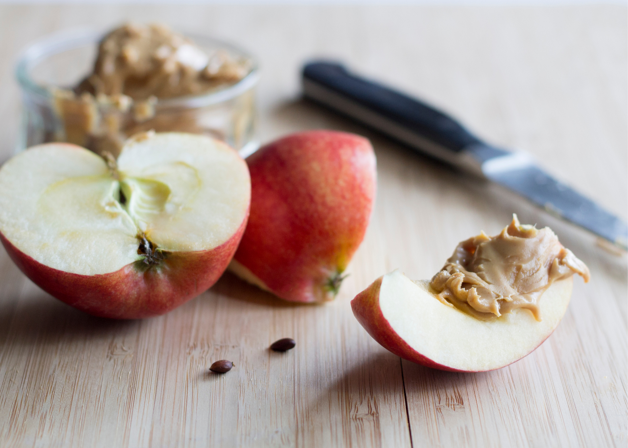 low calorie snack ideas, healthy recipes, losing weight, apples peanut butter, wood cutting board, red apple